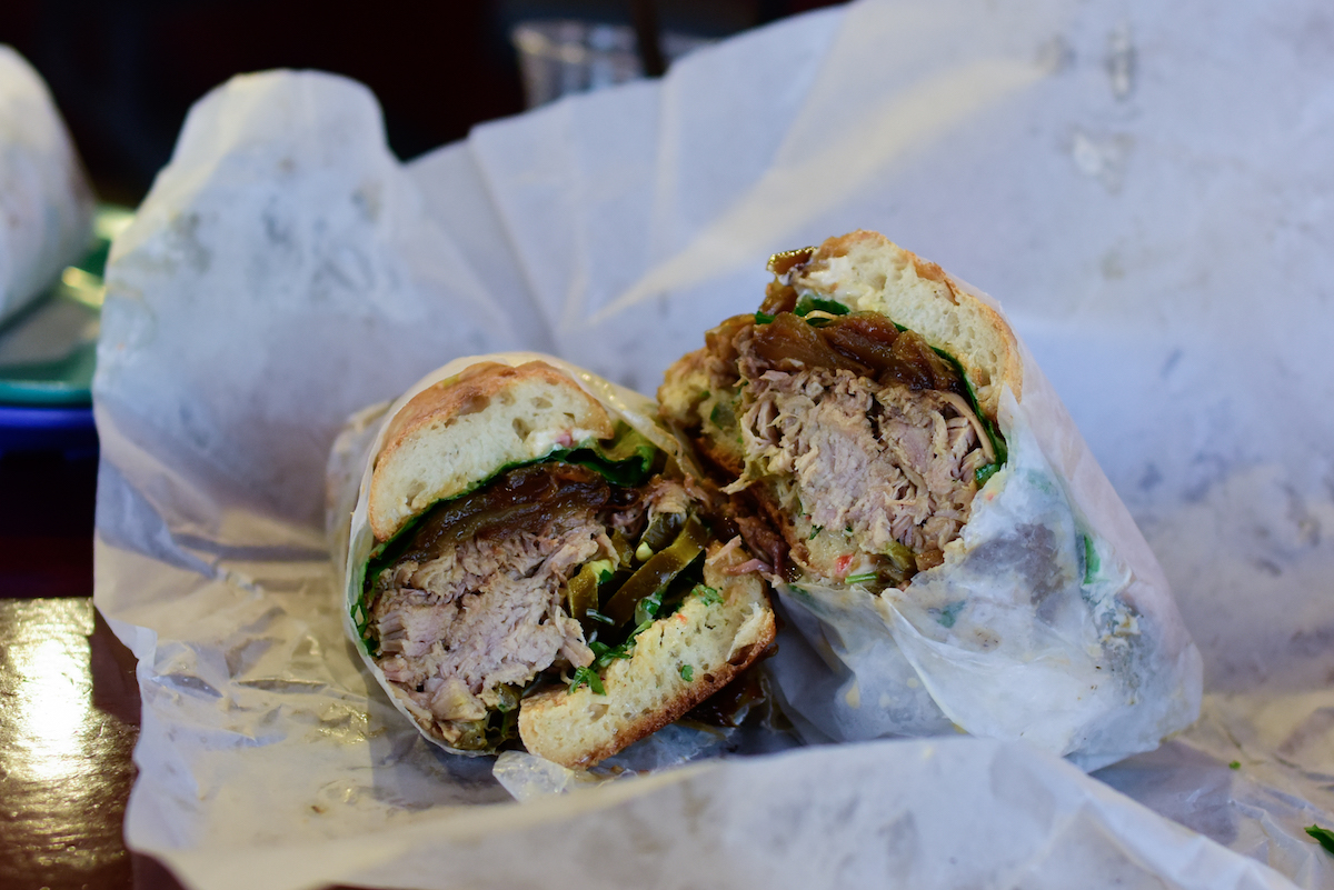 Paseo's Caribbean Roast came snuggly wrapped in layers of paper, which is good because the sandwich leached pork fat and spilled fillings like that was its job. But the tender meat and roasted onion was well worth the mess.