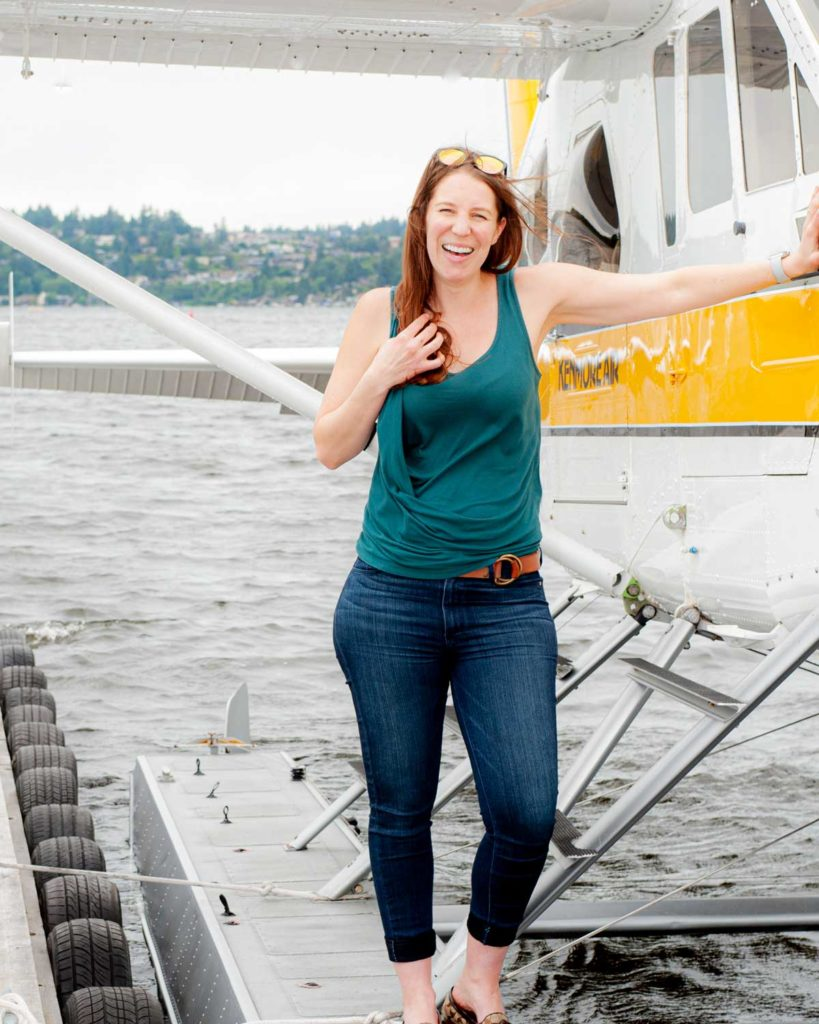 Mikaela Judd on the pontoon of a seaplane