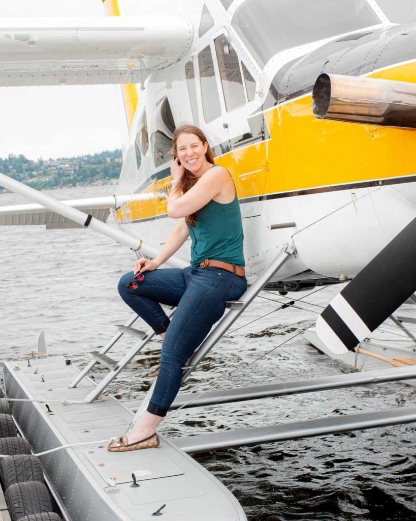 Mikaela Judd resting against the steps of a seaplane
