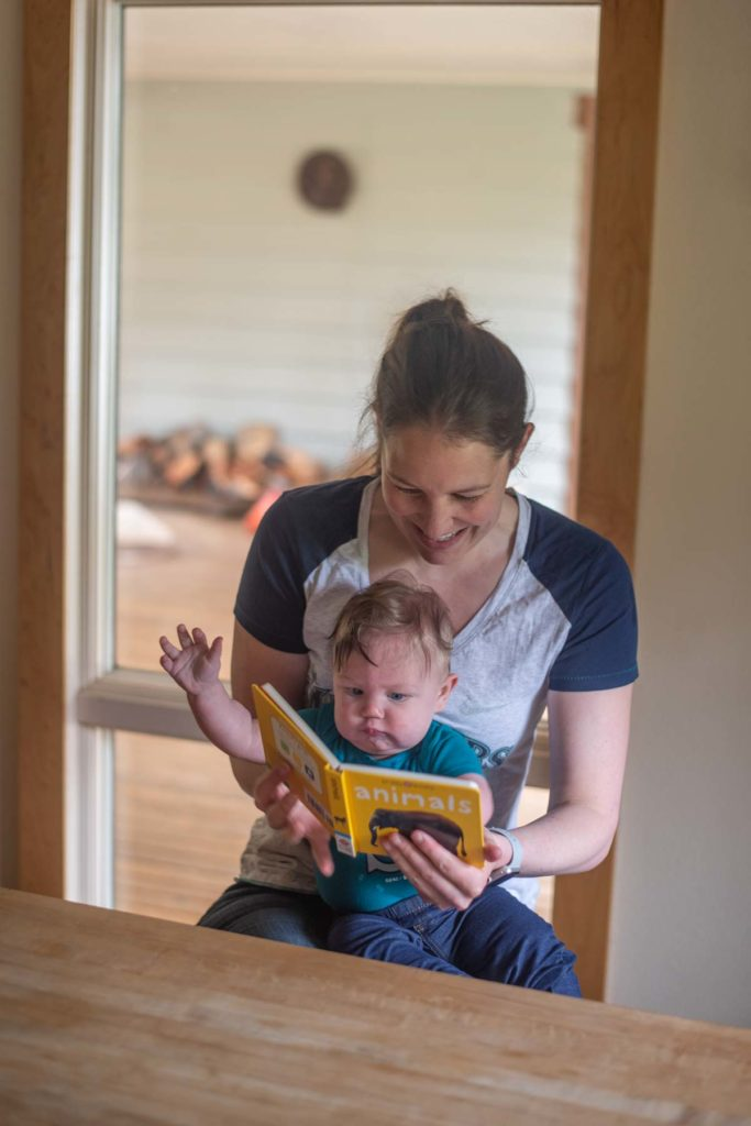 Reading books with a baby.