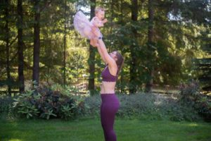 throwing a baby up in the air and catching her