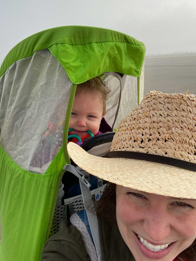 baby in baby carrier with rain guard