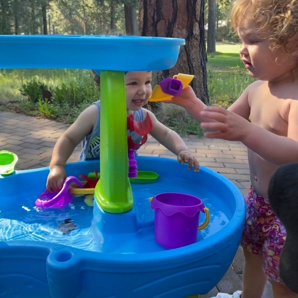 Babies playing in a water table.